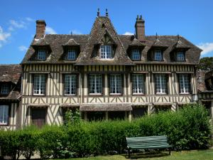 Lyons-la-Forêt - Half-timbered facade of the house of Maurice Ravel, bench in foreground