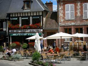 Lyons-la-Forêt - Café terrace, floral decorations (flowers) and facades of houses in the village