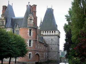 Maintenon castle - Renaissance-style castle and its square keep, trees along the water