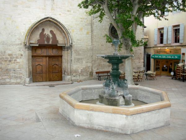 Manosque - Fountain of the Saint-Sauveur square, facade of the Saint-Sauveur church, plane tree, café terrace and house of the old town