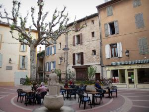 Manosque - Marchands square: statue, café terrace, plane tree and facades of houses in the old town