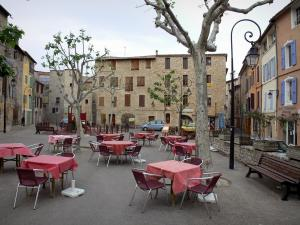 Manosque - Marcel Pagnol square: café terrace, plane trees, lampposts and houses of the old town