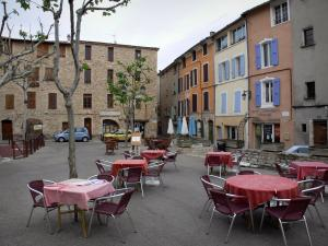 Manosque - Marcel Pagnol square: café terraces, plane trees and houses of the old town