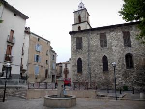 Manosque - Saint-Sauveur church and its bell tower topped by a campanile, fountain and houses of the old town