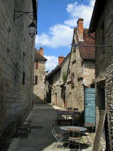 Martel - Narrow street, café terrace and stone houses of the city, in the Quercy