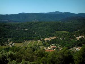 Massif des Maures mountains - Trees, villas (Provençal houses) and hills covered with forests