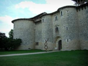 Mauriac castle - Castle (fortress) with towers, path and lawns