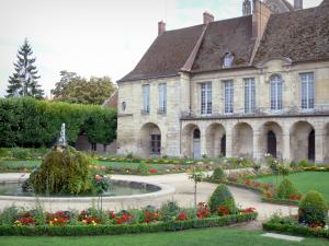 Meaux - Former Episcopal palace home to the Bossuet museum, Bossuet garden (French-style formal garden of the former bishop's palace) with rock of the pond, flowerbeds trees