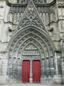 Meaux - Saint-Étienne cathedral of Gothic style: central portal and its carved tympanum depicting Last Judgement
