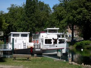 Melun - Banks of River Seine: moored boat and trees along the river