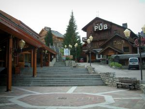 Méribel - Square in the ski resort (winter sports) with stair and wooden residences - chalets