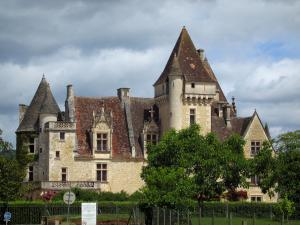 Milandes castle - Castle with a turbulent sky, in the Dordogne valley, in Périgord