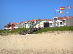 Mimizan-Plage - Sandy beach, flags and waterfront facades of the resort