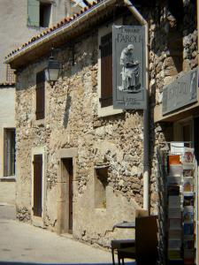 Minerve - Shop sign and houses of the village