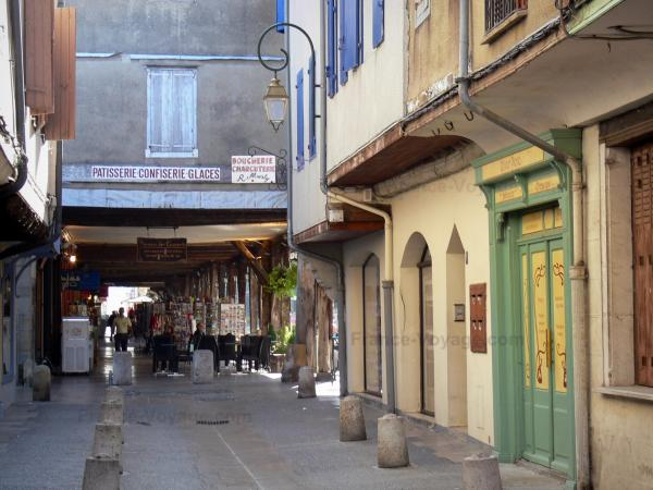 Mirepoix - Medieval bastide town: facades of houses and streets leading to the central square (place des couverts)