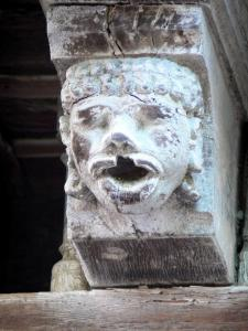 Mirepoix - Medieval bastide town: wood carving (carved head) of the Maison des Consuls