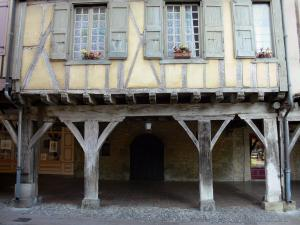Mirepoix - Medieval bastide town: half-timbered house over a wooden gallery from the central square (place des couverts)