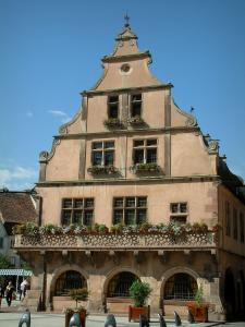 Molsheim - Metzig (Renaissance building with fretted cogs) with windows and balcony decorated with flowers