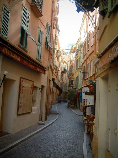 Monaco and Monte Carlo - Narrow paved street of the Monaco rock lined with colourful houses
