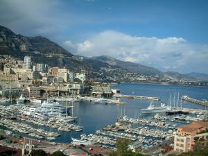 Monaco and Monte Carlo - Port of Monaco with its boats, yachts and cruise boats, buildings and mountain in background