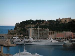 Monaco and Monte Carlo - View of the Monaco rock and of the port below with its boats and a big yacht, sea