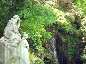 Monceau park - Monument to Ambroise Thomas and waterfall in a green setting