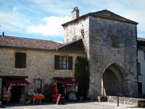 Monpazier - Fortified gate, houses and shop in the fortified town, in Périgord