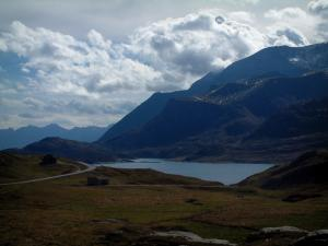 Mont-Cenis lake - Alpine pastures, lake (dam), mountains (massif of Mont-Cenis) and clouds in the sky, in Haute-Maurienne (peripheral zone of the Vanoise national park)