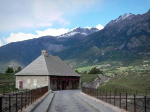 Mont-Dauphin - Citadel (fortified town built by Vauban): guardroom and bridge; mountains in background