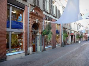 Montauban - Facades and shops of the Rue de la République street