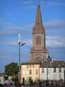 Montauban - Bell tower of the Saint-Orens church, facades of houses, lampposts, and flower-bedecked railings