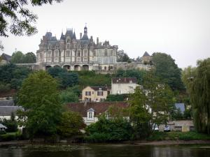 Montigny-le-Gannelon castle - Loir valley: castle overlooking the houses of the village, trees along the water, the Loir River