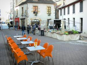 Montluçon - Café terrace, market stalls and houses of the old town