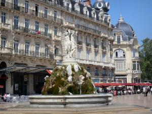 Montpellier - Comédie square with its Trois Grâces fountain, its cafe terraces and its buildings