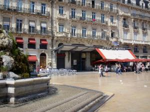 Montpellier - Comédie square with its fountain, its cafe terraces and its buildings