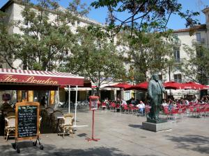Montpellier - Jean-Jaurès square, Jean Jaurès's statue, cafe terraces, trees and buildings of the city