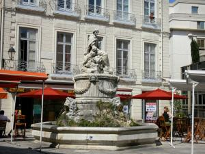 Montpellier - Fountain of the Chabaneau square, café terrace and its parasols, and buildings of the city