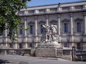 Montpellier - Statue on the Peyrou promenade and facade of the Palais de Justice (law courts)