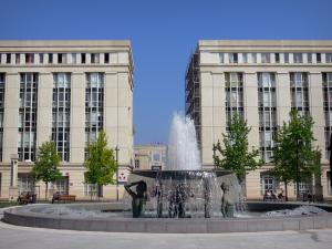 Montpellier - Antigone district: Thessalie square with its fountain, its benches, its trees and its buildings