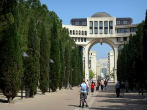Montpellier - Antigone district: Millennium square with its walk and its cypress, buildings