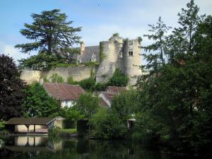 Montrésor - Surrounding wall and towers (remains) of the fortress, castle, houses of the village, trees and washouse by the River Indrois