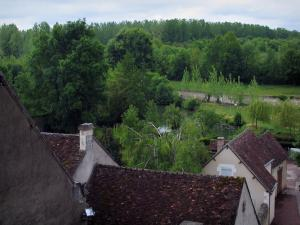 Montrésor - Houses of the village with view of the River Indrois and trees