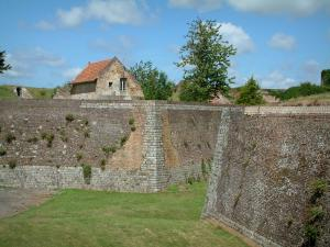 Montreuil-sur-Mer - Moat, citadel ramparts and clouds in the sky