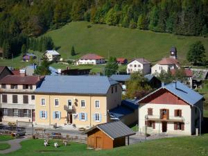 Monts Jura resort - Winter and summer sports resort (ski resort): Mijoux village: houses and church surrounded by meadows; in the Upper Jura Regional Nature Park (Jura mountain range)