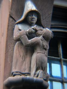 Moret-sur-Loing - Wooden statue (sculpture) on the facade of an old house
