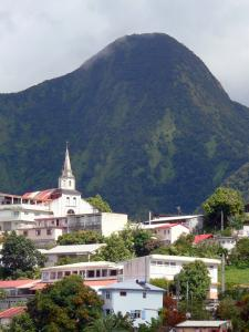 Le Morne-Vert - St. Martin Church and houses of the village at the foot of the Carbet Peaks
