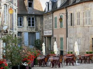Moulins - Café terrace, floral decoration (flowers) and facades of houses in the old town