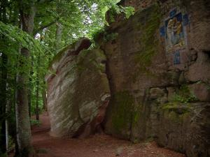 Mount Sainte-Odile - Pink sandstone cliff, a ceramic station of the way of the Cross and trees in the forest
