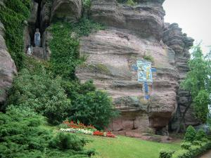 Mount Sainte-Odile - Pink sandstone cliff, a ceramic station of the way of the Cross, plants, flowers and a tree
