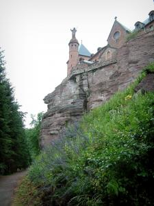 Mount Sainte-Odile - Convent (monastery) perched on the pink sandstone cliff, footpath, bushes and trees